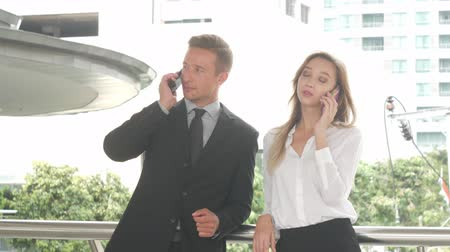 trabalho em equipe : Business man and business women using smart phone, Business concept.