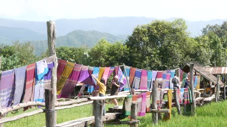 varal : NAN, THAILAND OCTOBER,13 - 2018 : People visit and drink coffee with  Green Terraces rice field at Ban-Tai-Lue Café Pua district, Nan Thailand. Cafe decorated place with beautiful native fabric.