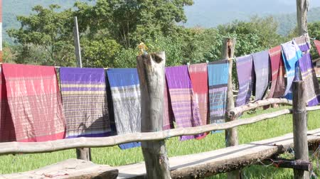 clothesline : NAN, THAILAND OCTOBER,13 - 2018 : People visit and drink coffee with  Green Terraces rice field at Ban-Tai-Lue Café Pua district, Nan Thailand. Cafe decorated place with beautiful native fabric.
