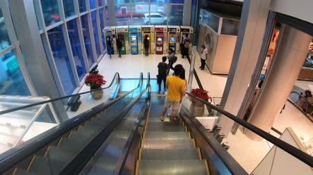 escalators : BANGKOK, THAILAND - December 10, 2016 : People are pressing money at the ATM to take money before shopping at in the Paragon shopping mall, Bangkok, Thailand