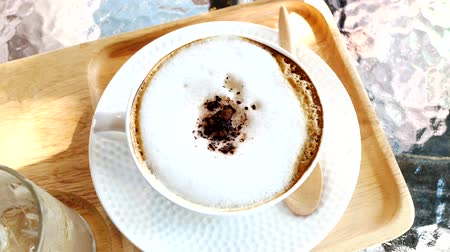 aromatik : A cup of cappuccino coffee on wooden table in the morning. Stok Video