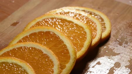 Round slices of orange on a cutting board
