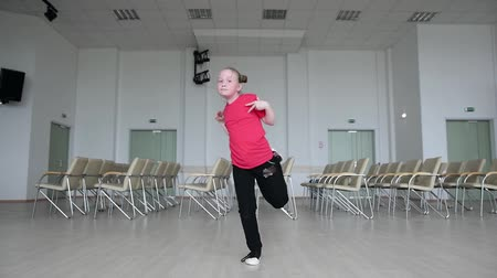 hiphop : Young girl dancing hip-hop indoors. Footloose