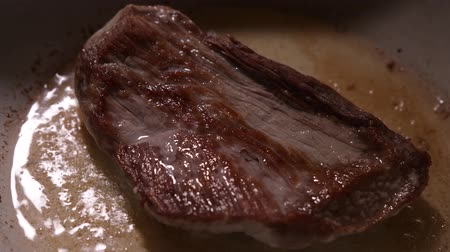 beef dishes : Cooking raw steak on the pan Stock Footage
