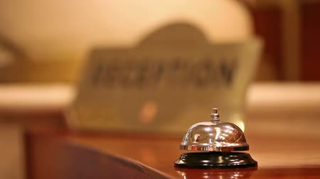 reception : call on a old hotel bell on a wood stand Stock Footage