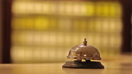 sinos : call at old hotel bell on a wood stand