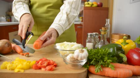 chef cooking : Female hands peeling carrot dolly shot Stock Footage