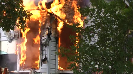 firemen : Fire climbing the wall of a burning house. Stock Footage