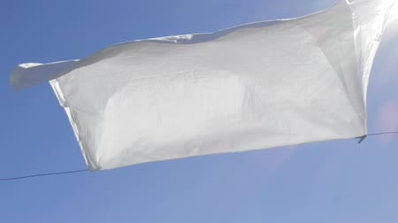 sheet : White sheet drying by a sunny and windy day Stock Footage