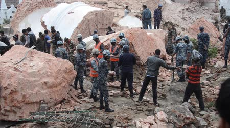 KATHMANDU NEPAL  APRIL 26 2015: Nepal Armed Police Force army police and civilians start rescue efforts at the collapsed Dharhara tower after the 7.8 earthquake on 25 April 2015.