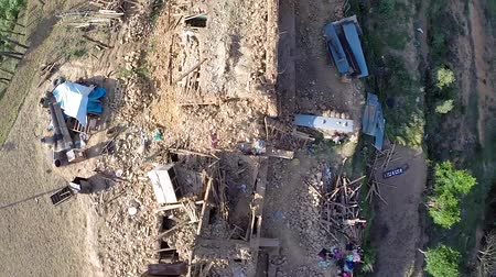 assess : KOTDANDA NEPAL  MAY 2 2015: Drone footage of damaged houses in the village after a 7.8 earthquake hit Nepal on April 25 2015.
