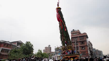 patan : PATAN, NEPAL - MAY 10, 2016: God of Rain Rato Machhindranath chariot festival. Rato Machhindranath is worshiped as the god of rain. The chariot is pulled through the street of Patan for about a month.