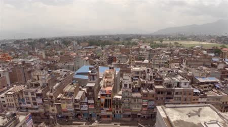 KATHMANDU, NEPAL - APRIL 18, 2015: Drone footage of Bagbazar area in Kathmandu. The now collapsed Dharahara Tower visible on the right. Stok Video