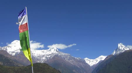 The Annapurna range in Nepal. Prayer flags in the foreground.