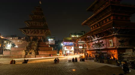BHAKTAPUR, NEPAL - NOVEMBER 15, 2015: Bhaktapur dusk to night time-lapse cinemagraph on Taumadhi square with Nyatapola temple on the left and  Bhairavnath temple on the right.