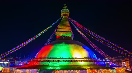 bodhnath : Time-lapse of the renovated Boudhanath stupa lit for its inauguration in Kathmandu, Nepal Stock Footage
