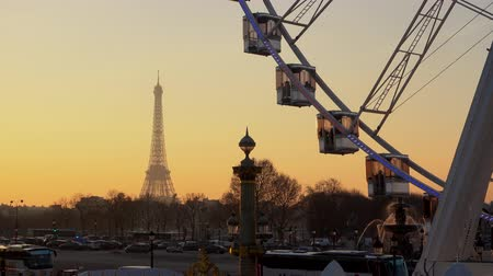 The ferris wheel and the Eiffel Tower as seen from the Tuileries garden in Paris, France