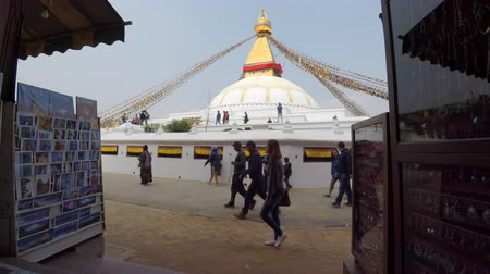 bodhnath : KATHMANDU, NEPAL - CIRCA FEBRUARY 2018: People walking around Boudhanath stupa. Boudhanath is a UNESCO World Heritage Site