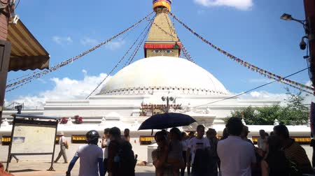 bodhnath : KATHMANDU, NEPAL - CIRCA SEPTEMBER 2018: Boudhnath stupa as seen from the main entrance with 3D audio. Stock Footage