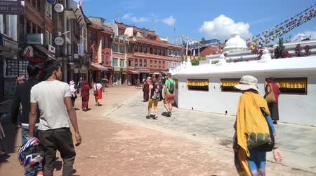 bodhnath : KATHMANDU, NEPAL - CIRCA SEPTEMBER 2018: People walk around Boudhanath stupa. With 3D audio.