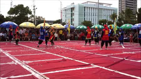 pisos : Nha Trang, Vietnam - July 15, 2015: Human chess performed with martial art on the beach festival