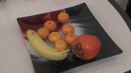 Banaan persimmon mandarijnen Stockvideo
