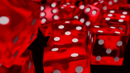 saray : Dice rolling red slow motion closeup DOF on black
