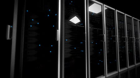 serwerownia : Data center servers glass fronted flashing lights tracking shot centre