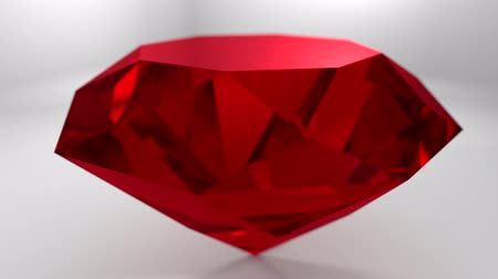 драгоценные камни : Ruby red gemstone spinning, wedding background loop 4K