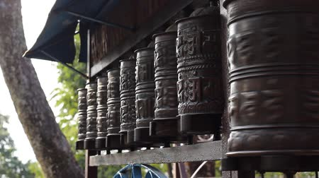 modlitba : Mans hand turns prayer wheels