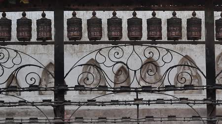 modlitba : A set of rotating prayer wheels. Sliderdolly shot