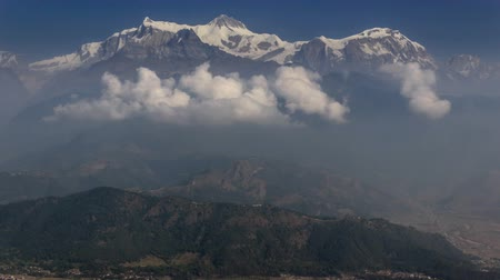 tybet : Timelapse of clouds form below the top of Annapurna South