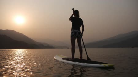 remo : Paddleboard at sunset