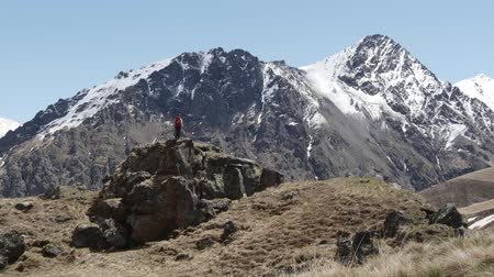 difficults : Woman stands on a rock in front of the magnificent mountain
