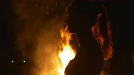 ведьма : Profile of a woman on a background of a fire