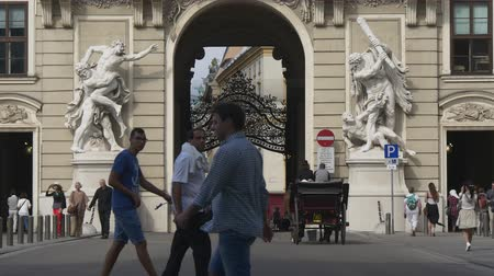 hofburg : Horse drawn carriage move towards hofburg arch Stock Footage