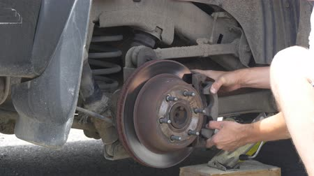 wayside : Fixing car wheel on the road Stock Footage