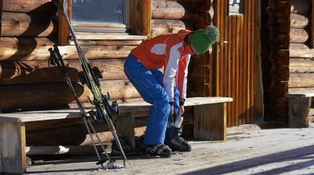 fasteners : Young woman ready for skiing Stock Footage