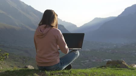 looking far away : Freelancer works in the mountains