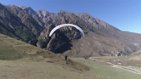 Paraglider take off. Following with the drone