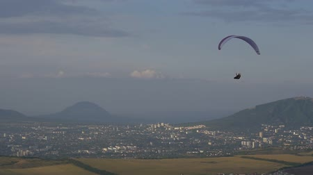 Paraglider against the evening city