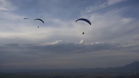 Paragliders in the deep blue sky