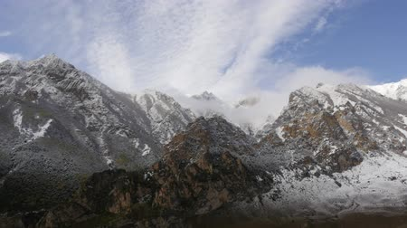 Timelapse of dolomite mountains cowered by the first snow