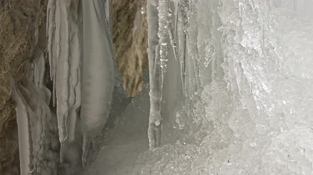 sincelo : Ice stalactites in a mountain cave in winter Stock Footage