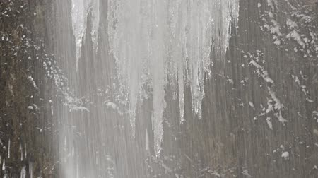 icy : Jets of water of an ice waterfall on a background of icicles