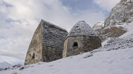 доисторический : Historical grave crypts in the mountains in winter Стоковые видеозаписи