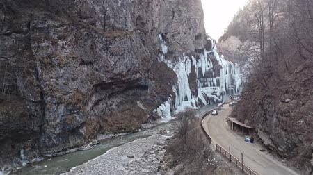 rampouch : Aerial view of a frozen waterfall in a narrow mountain gorge