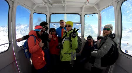 funicular : Group of tourists inside the gondola of cableway Stock Footage