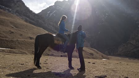 dizgin : Guy with a girl and a horse in the mountains