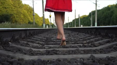 jump away : Barefoot girl running on railway
